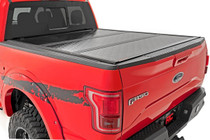 2020 2500/3500 HD GM Low Profile Hard Tri-Fold Tonneau Cover | 6.9' Bed w/ Rail Caps