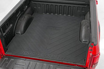 "Dodge Bed Mat w/ RC Logos (03-18 Ram PU | 6'4"" Bed) displayed inside vehicles bed"