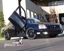 Vertical Doors 2000-2005 CADILLAC DEVILLE Bolt on Lambo Door Kit - displayed on a vehicle
