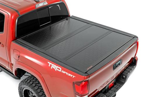 16-20 Toyota Tacoma Low Profile Hard Tri-Fold Tonneau Cover