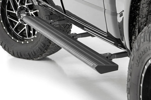2019-2020 Dodge Ram 1500 Crew Cab Electric Retractable Running Board Steps  displayed open on vehicle