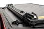 GM Low Profile Hard Tri-Fold Tonneau Cover (19-20 1500) underside of tonneau cover with latch and mount system