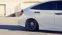 2017-2021 Honda Civic Si Air Lift Strut Kit w/ Manual Air Management displayed on vehicle passenger side rear