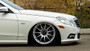 2010-2016 Mercedes E-Class (W212/S212) CLS-Class (W218/C218/X218) RWD Air Lift Front Air Strut Kit w/ Manual Air Management w/o Shocks close up of wheel when vehicle lowered