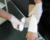 Medium Dressing with Bandage Sterile HSE 12 x 12cm Pad action