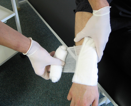 Large Dressing with Bandage Sterile HSE 18 x 18cm Pad action