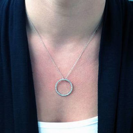 https://d3d71ba2asa5oz.cloudfront.net/53000589/images/circle%20pendant%20head%20on.jpg