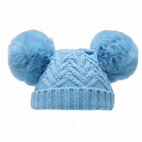 Blue chevron knit hat with Blue faux fur double pompoms and detail