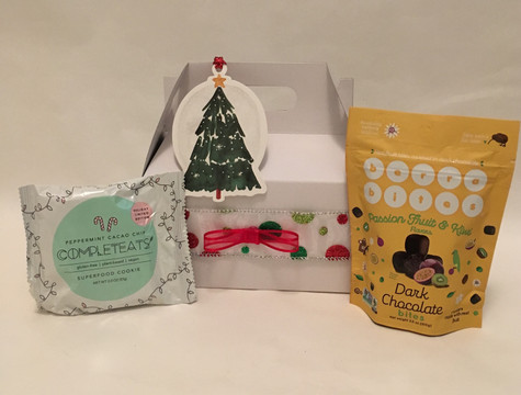 This festive box contains healthy snacks for the holidays.  A 3.5 ounce bag of Berra Bites, Mixed Berry or Passion Fruit flavor.  Also a Completeats Super Food Cookie, Peppermint Cacao, Cherry Almond or Chocolate Chia flavor.  Choose box decorated in traditional or snowflake.