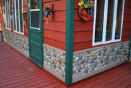Clapboard Cabin Remodel with River Rock