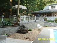 Poolside Backyard Design with Faux Stone Wall Siding