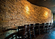 Curved Wall Design with Faux Stone Panels