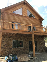 Finishing the Exterior Foundation Walls of a Log Cabin