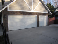 Garage Exterior Remodel with Panels and Trim