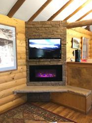 A Cozy Log Cabin Fireplace