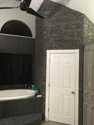 Stacked Stone Bathroom Wall Adds Luxurious Style