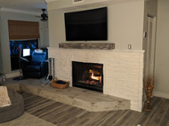 Faux White Stone Fireplace Fits a Beachy Decor