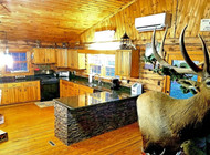 Rustic Kitchen Island in a Lodge Style Home