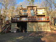 Stilt House Remodel with Stone Wall Siding