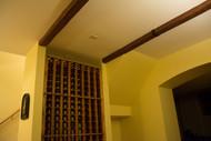 Wine Cellar Gets a Vintage Look with Faux Wood Beams