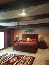 Southwestern Bedroom Gets Rustic with Beams