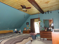 Operation Ugly Ceiling: A Timber Beam Rescues a Bedroom