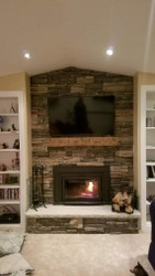 Real Stone Fireplace Finished With a Faux Mantel