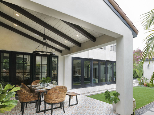 Outdoor patio ceiling using our Woodland Faux Wood beams in the java color.