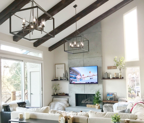 Living room vaulted ceiling decorated with our Beachwood Faux Wood beams in the java color.