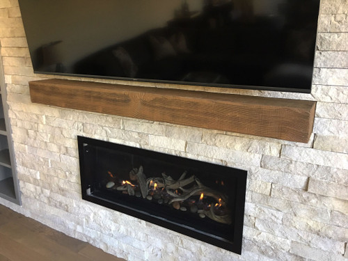 Beachwood Faux Wood mantel in the walnut color used to decorate this fireplace.