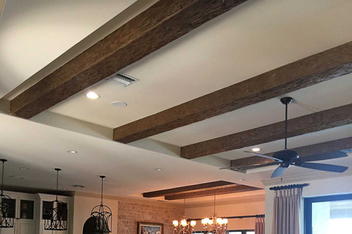 This living room ceiling decorated with our Tuscany Faux Wood beams in the walnut color.