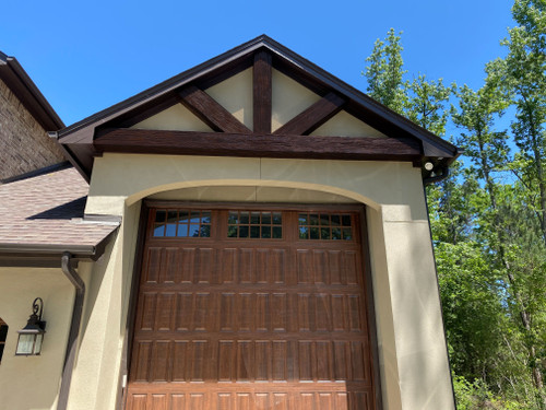 Outdoor truss over this home's garage door using our Heritage Faux Wood beams in the java color.