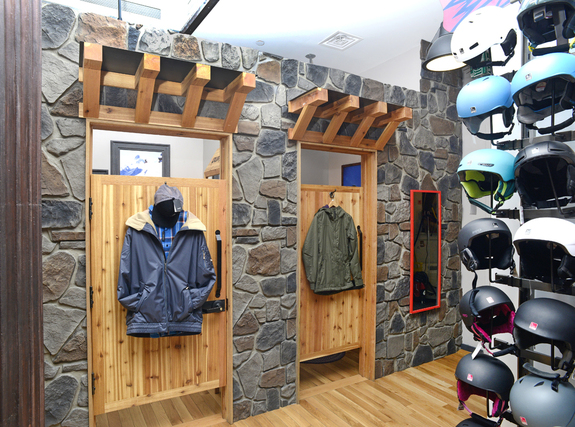 Our Carlton Fieldstone Stone Wall panels in the smoke color used to decorate a fitting room at a snowboarding shop.