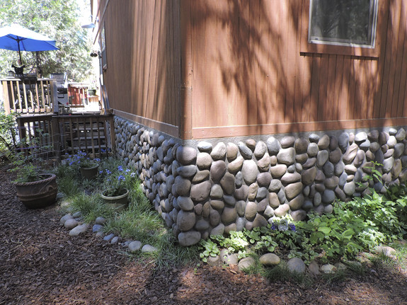 Our River Rock panel in multicolor used outdoors as skirting for this home.