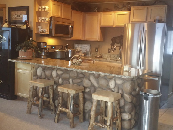Kitchen island paneled with our River Rock panel in our mixed tan color.