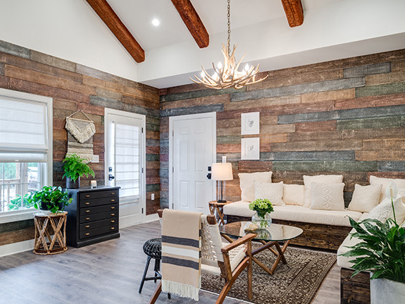 Living room paneled with out Reclaimed Shiplap Barn Wood Wall panels in the rustic color.