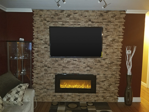 Our End Grain Wood Wall panels in the seaside color used to panel a fireplace/media center in this living room.