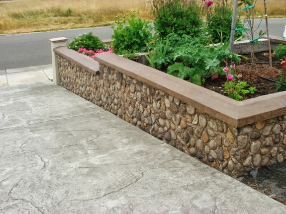 Wall cap used in the tan color to cover this driveway retaining wall.