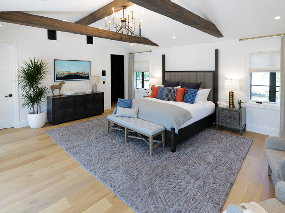 Bedroom ceiling decorated with our Timber Faux Wood beam in the rich walnut color.
