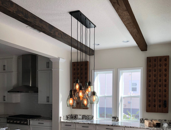 Kitchen ceiling using our Hand Hewn Faux Wood beams in the dark walnut color.