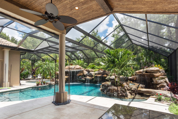 Outdoor pool patio area using our Rough Hewn faux wood beams in walnut on the ceiling along with our matching planks.