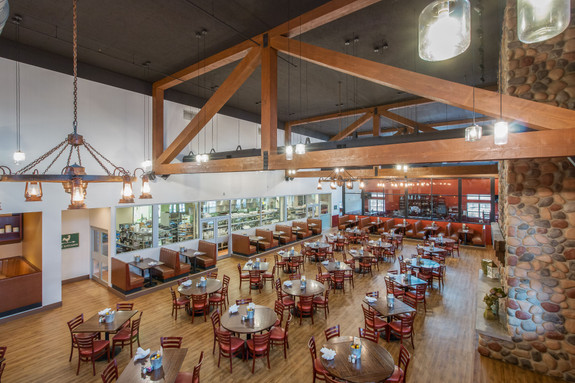 Restaurant ceiling using our Rough Sawn Faux Wood beams in the oak color.