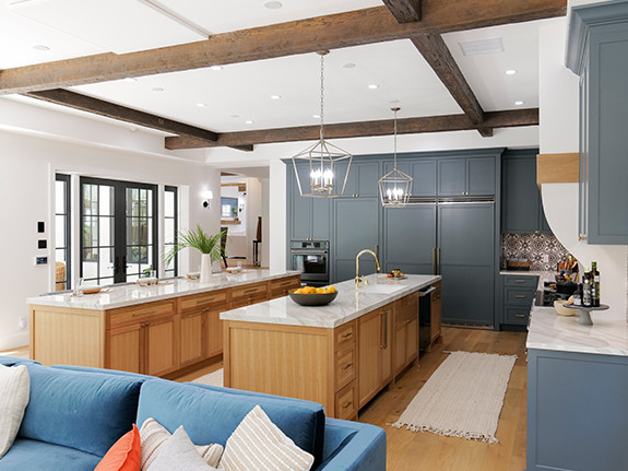 Our Tuscany Faux Wood beams in the walnut color used on this kitchen ceiling.