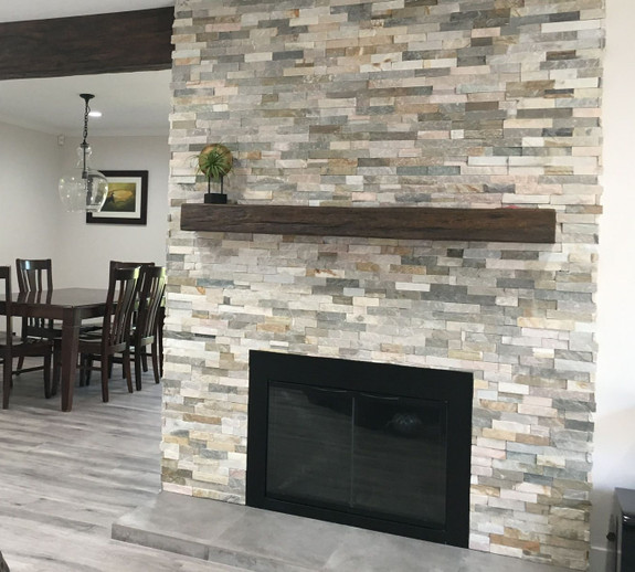 Our Timber Faux Wood mantel in rich walnut used to decorate this stone fireplace.