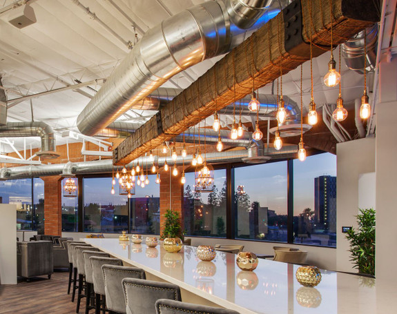 Industrial ceiling of this restaurant using our Timber Faux Wood beam in the rich walnut color.