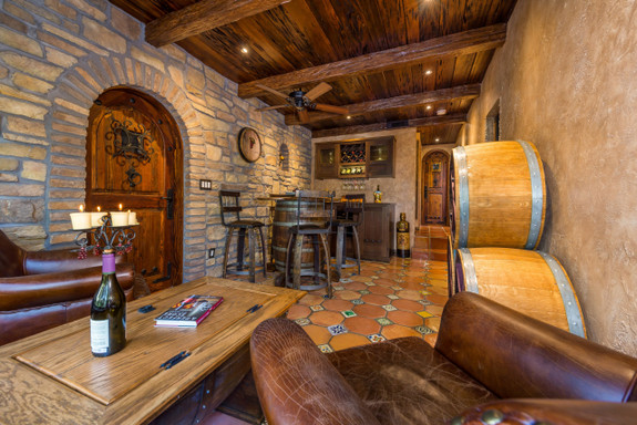 Wine cellar ceiling decorated with our Timber Faux Wood beam in the rich walnut color.