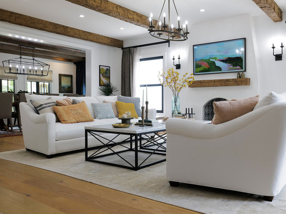 Our Rough Hewn Faux Wood Beams & Mantel in the walnut color used to decorate this living room.