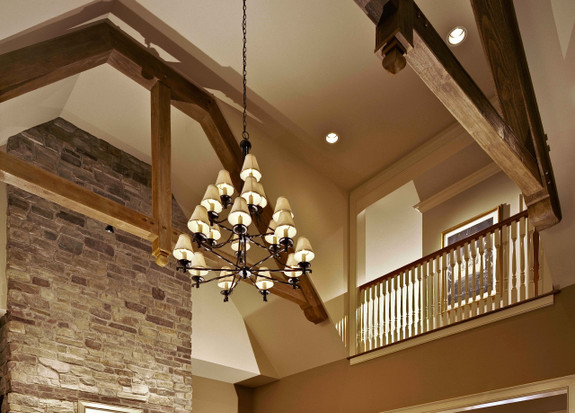 Heavy Sandblasted Faux Wood beams in rich walnut used as decorative trusses in this cathedral ceiling living room.