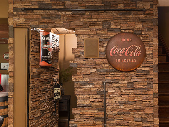 Colorado Dry Stack Stone Wall Panels along with outside corners in our sierra brown color used to create a hidden door that blends with the wall.