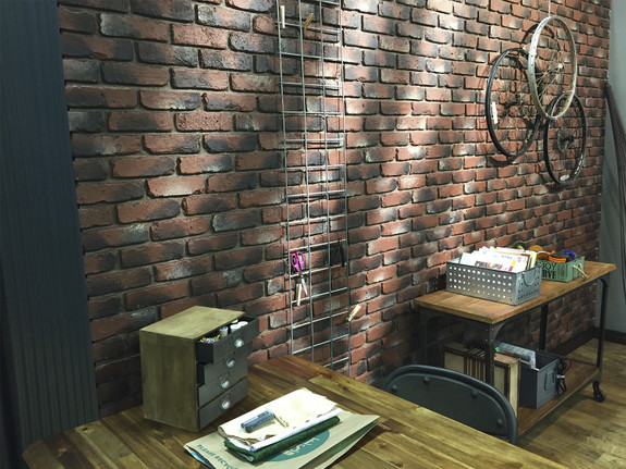 Our Old Chicago Brick Wall panels in the antique brick color used to decorate this office space.